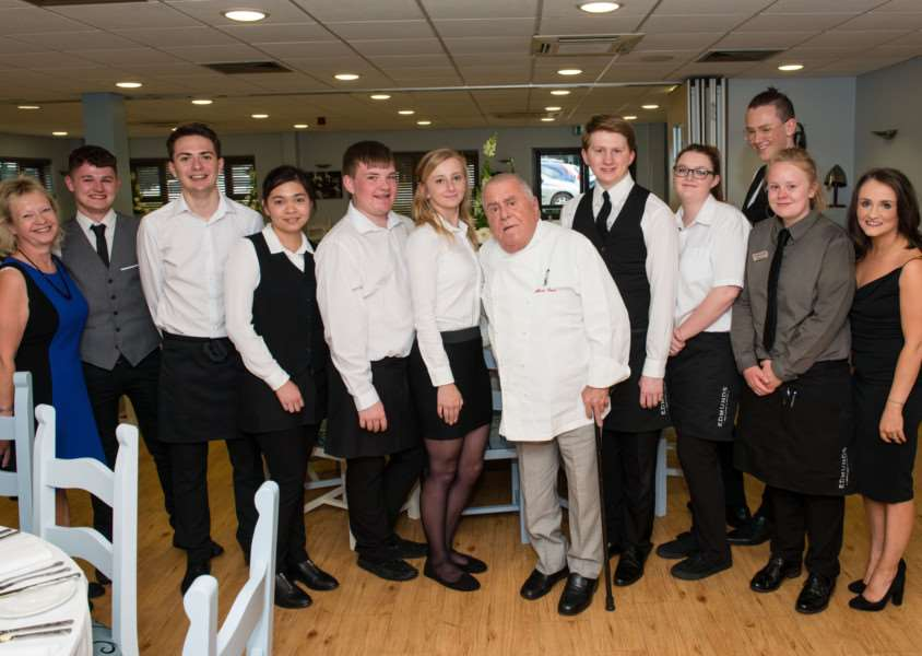 west suffolk college albert roux dinner - albert roux with students doing front of house