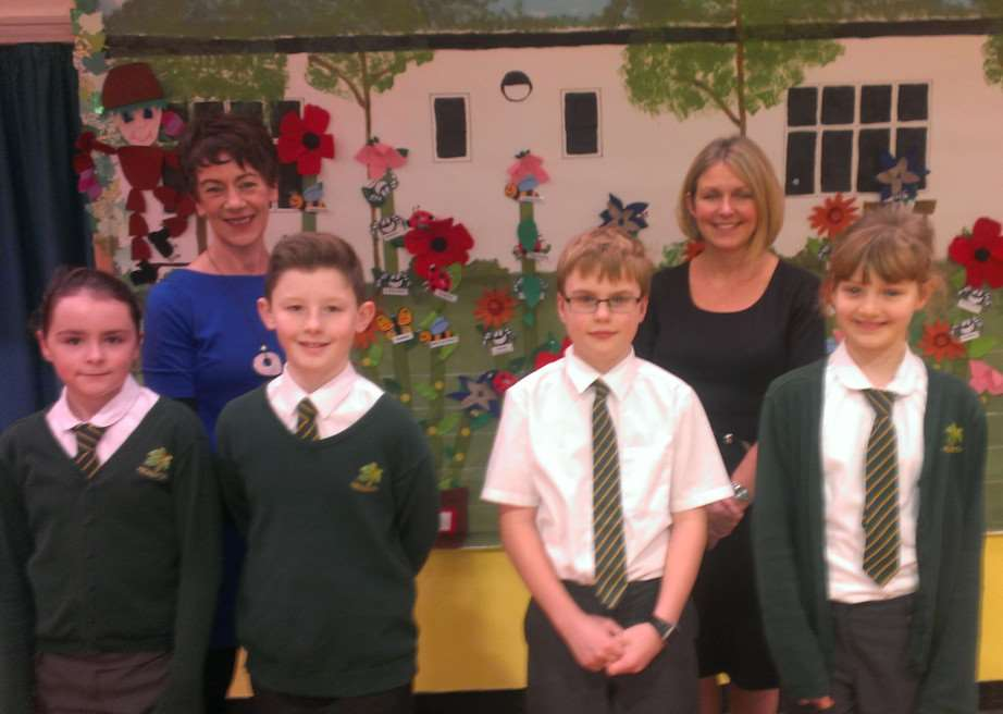 Kedington Primary Academy's new head teacher Karen Sheargold (right) and deputy head Soo Miller with some of their pupils ANL-150116-121021005