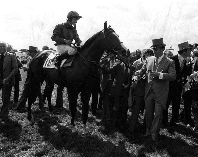 File photo dated 03-06-1981 of Shergar during the lead in by owner Aga Khan (top hat) with jockey Walter Swinburn after winning the Derby Stakes Classic at Epsom. EMN-160306-093220002