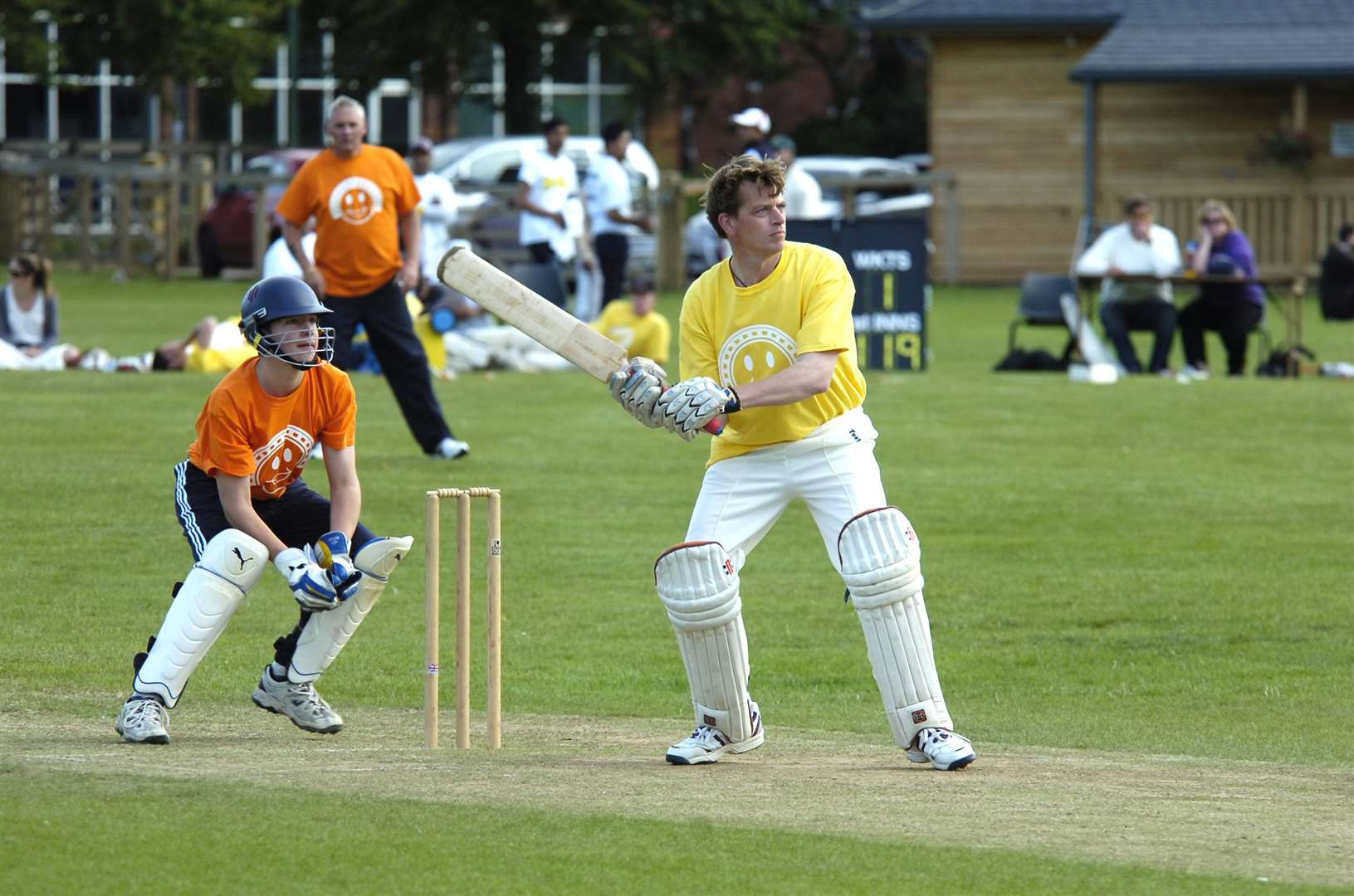 Action from a charity cricket match on The Severals in 2011
