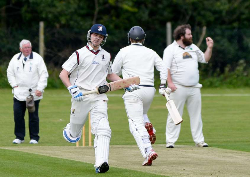 Batsmen Anthony Phillips and Dan Poole cross for a run during an over by Copford's Kieran Savill during Haverhill's four wicket defeat. Picture: Tudor Morgan-Owen.