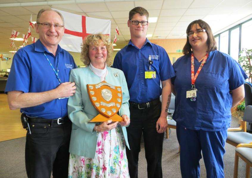 Porters Jack Sanderson, Matt Hart and Linda Axton with Lesley Williams holding the shield