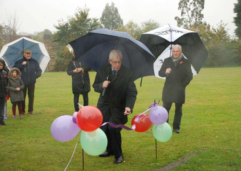 County councillor, David Finch cutting the ceremonial ribbon at Ridgewell Village Hall. ANL-161125-163909001