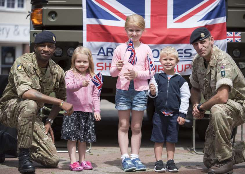 Members of the Royal Logistic Corps with Charlotte, 6, Harvey, 3, Hayley Ledain, 4, from Haverhill at Saturday's Armed Forces Day event.'Picture Mark Westley ANL-160627-090907009