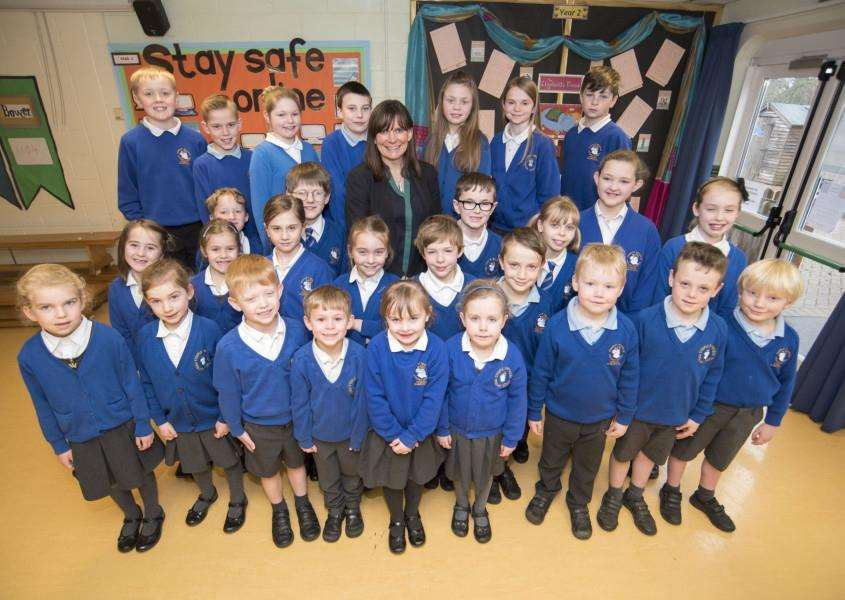 Steeple Bumpstead Primary School is joining Samuel Ward Academy Trust and has had an impressive monitoring report. Headteacher Mary Nicholls is pictured with some of the pupils. Picture by Mark Westley