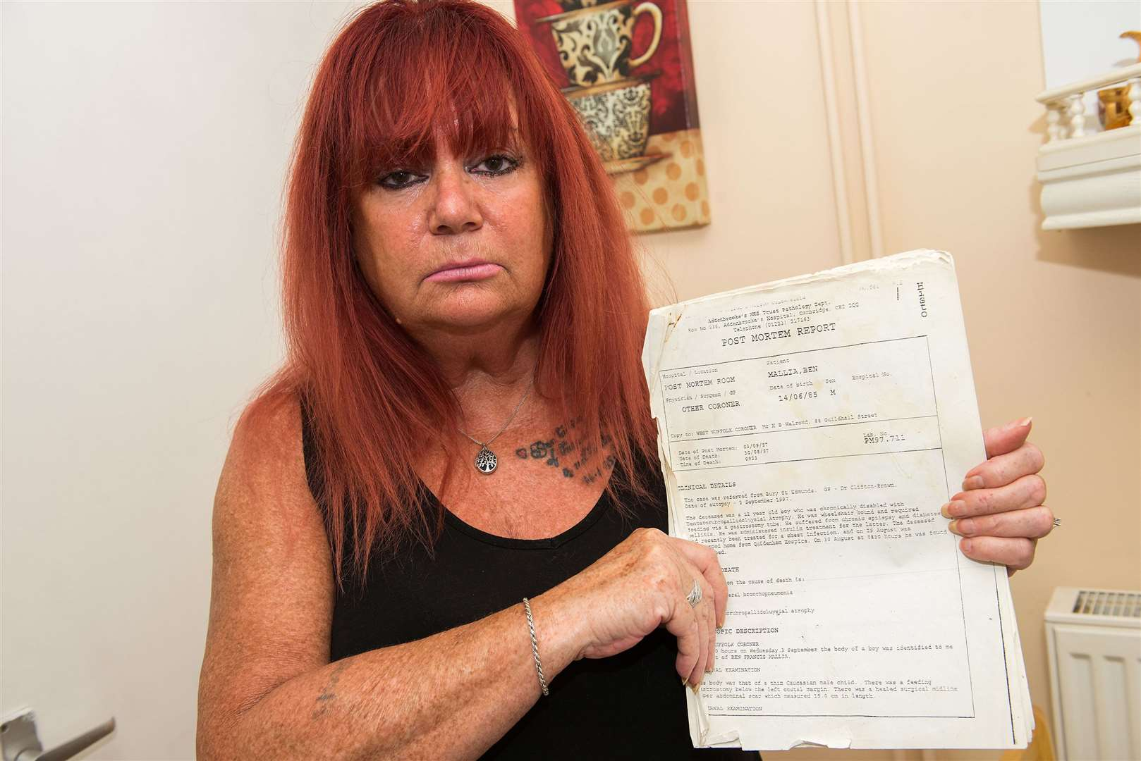 June Bayley with the autopsy report following her son's death. Picture: Mark Westley.
