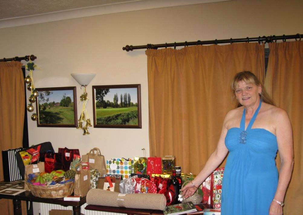 HTTA chairman Elaine Mcanus with the raffle prizes at its recent annual dinner party ANL-141012-130747005