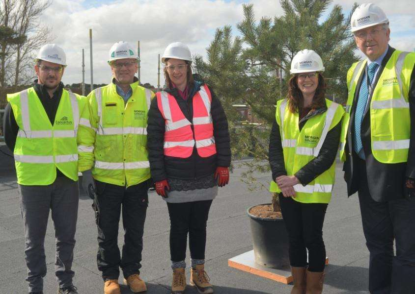 Steve Ryles, architect; Steven Palmer, site manager; Nichola Connor, primary head of group; Kerry Darby, headteacher; and Cllr Gordon Jones at the topping out ceremony at The Pines school, in Red Lodge