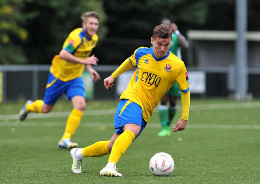 WINNING GOAL: Summer signing Liam Wales scored what proved to be the winning strike for Jamie Godbold's Yellows at a wet Wroxham on Saturday