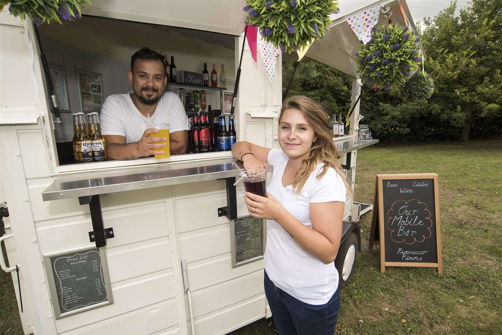 Haverhill Emilie Wilkins & Filipe Ferreira have started their own business, a mobile bar that is a converted vintage horse box. . Picture Mark Westley. (3628473)
