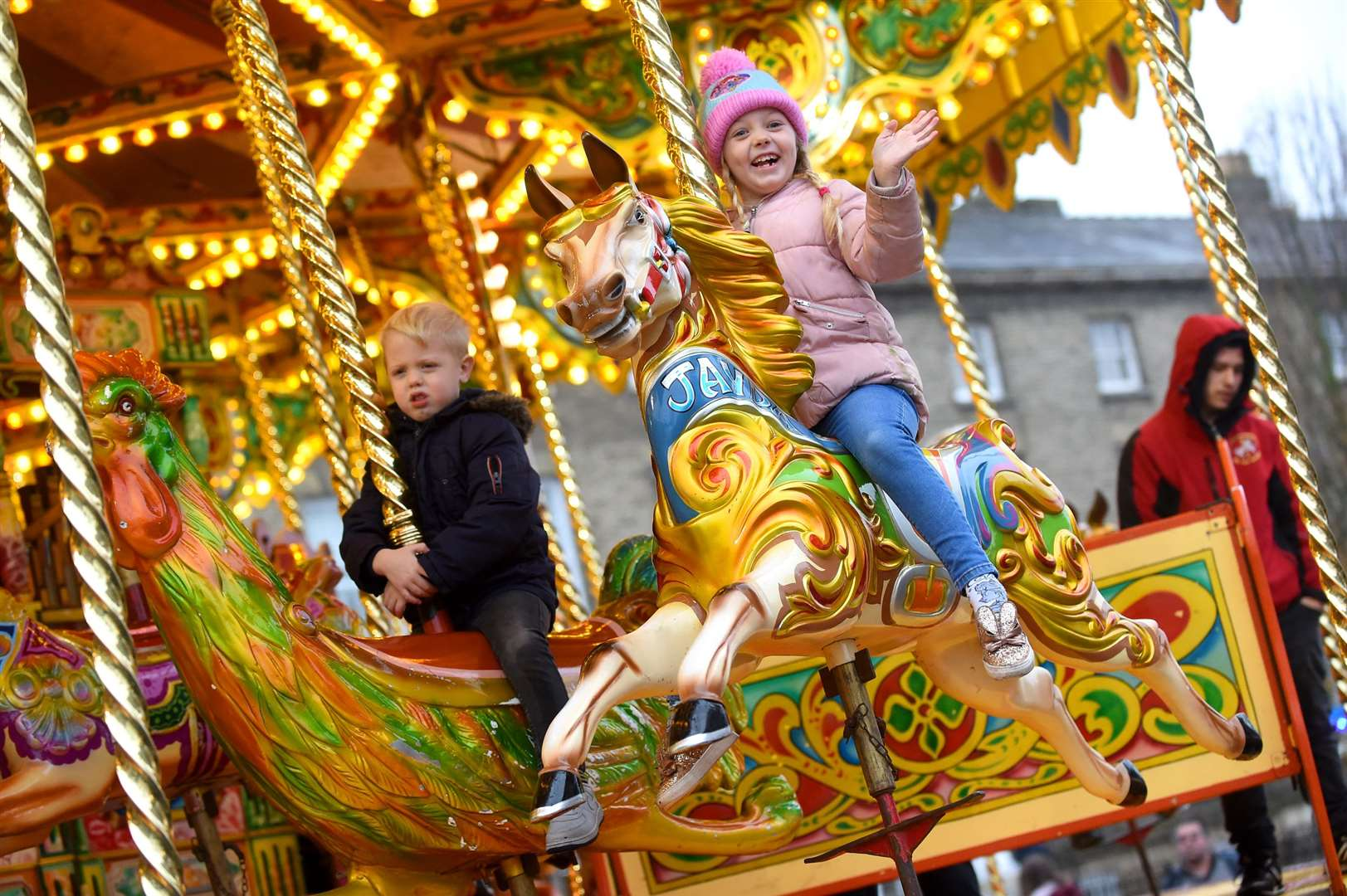 Bury St Edmunds Christmas Fayre 2019...Pictured: Daniel (5) and Lily Heal (7) enjoying the carousel ....PICTURE: Mecha Morton ..... (22425848)