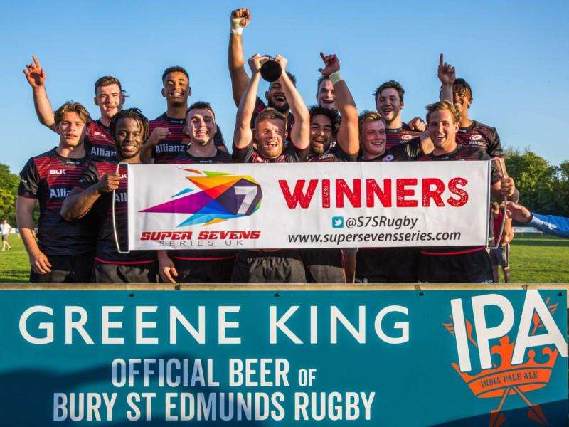 WINNERS: Saracens collect their trophy after winning the Greene King IPA Sevens tournament at Bury St Edmunds. Picture: Shawn Pearce