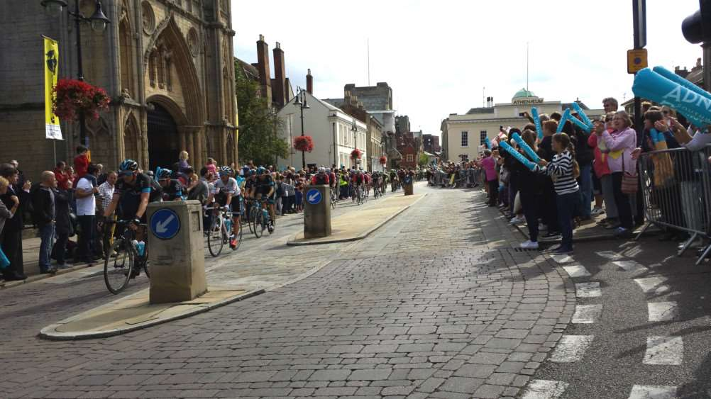 The Tour of Britain peloton speeds through Bury St Edmunds ANL-151209-152304001