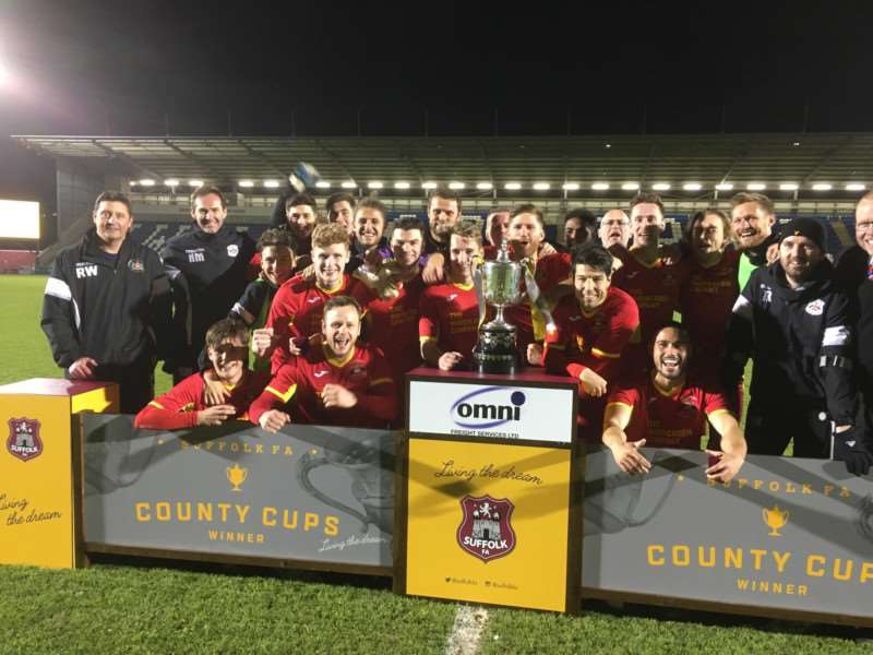 Needham Market players and management celebrate their Suffolk FA Premier Cup success at Colchester United FC Picture: Ben Pooley