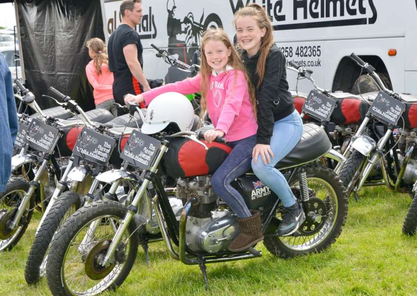 Hadleigh Show 2016 at Holbecks Park. Brooke (10) and Kara (13 O' Keefe on a White Helmet's Motorcycle ANL-160522-142051009