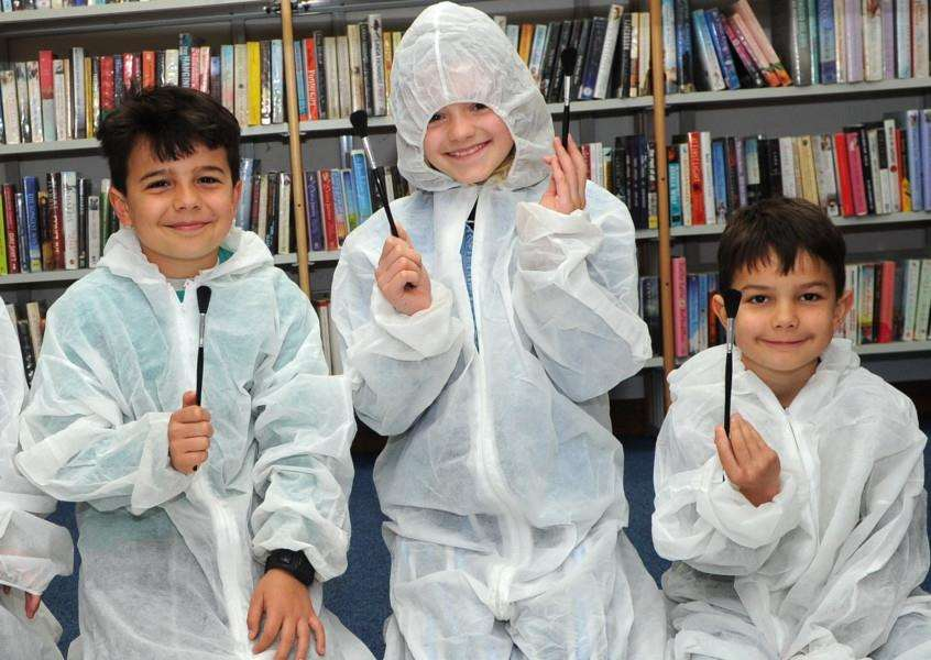 Joseph Besley, six, Imogen Porch, 10, and Noah Besley, nine, at the 'crime scene' PICTURE: Mecha Morton