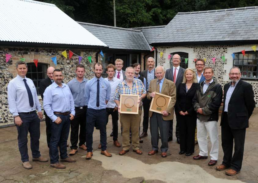 People involved in the restoration pictured with John Bowes and Ronald Rule who were presented with framed piston rings as part of the opening celebrations