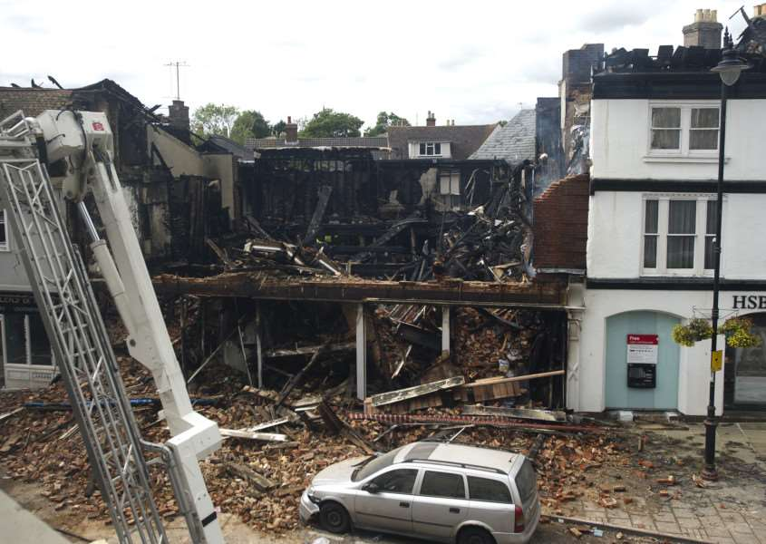 What's left of the Oxfam shop in Sudbury after a fire destroyed the building