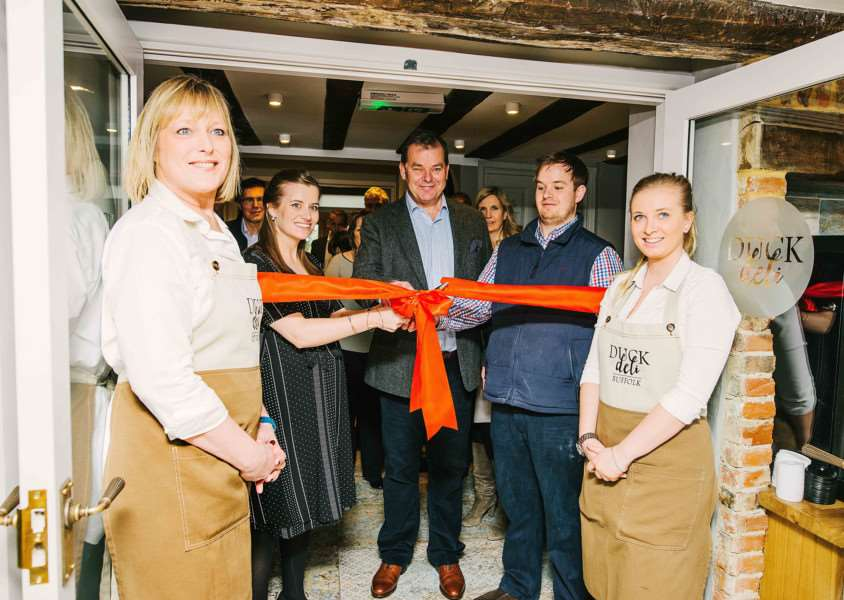 The Long Melford Swan expansion is marked by a ribbon cutting event with owners Lorna Pissarro, Andrew Macmillan and Oliver Macmillan.