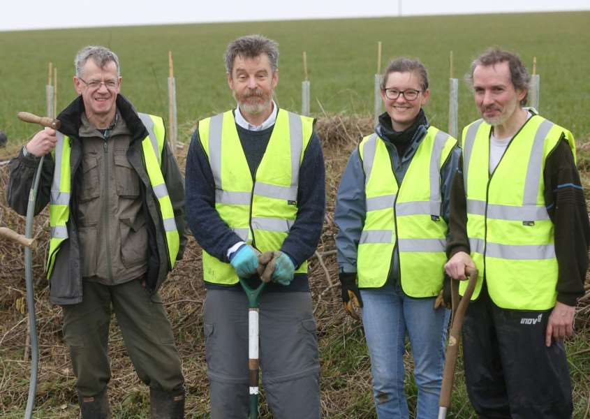 Mark Prina (Far L), Foxearth Meadows Nature Reserve manager pictured with volunteers as they plant new hedgerows near Foxearth.'Pic - Richard Marsham