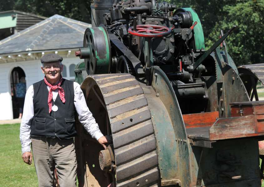 Museum volunteer Brian Hurr with a 1919 Walsh and Clark ploughing engine ANL-150908-222231009