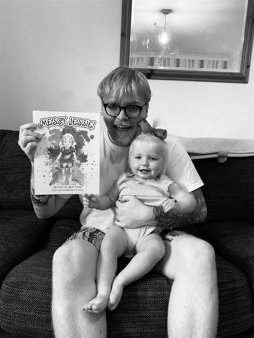 Jack Trott with daughter Jessica-Rose and his children's illustrated book. Contributed picture
