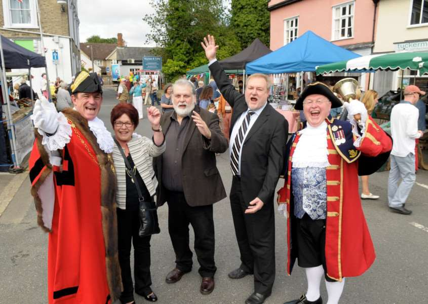 Clare, Suffolk. Clare's monthly market returns after an absence of 20 years. Celebrating from left Terry Clements Mayor of St Edmundsbury, Vivienne Clements, Paul Bishop Chairman of Clare Town Council, Alaric Pugh Borough Councillor for Clare and Mike Wabe Thetford Town Crier.''Picture: MARK BULLIMORE