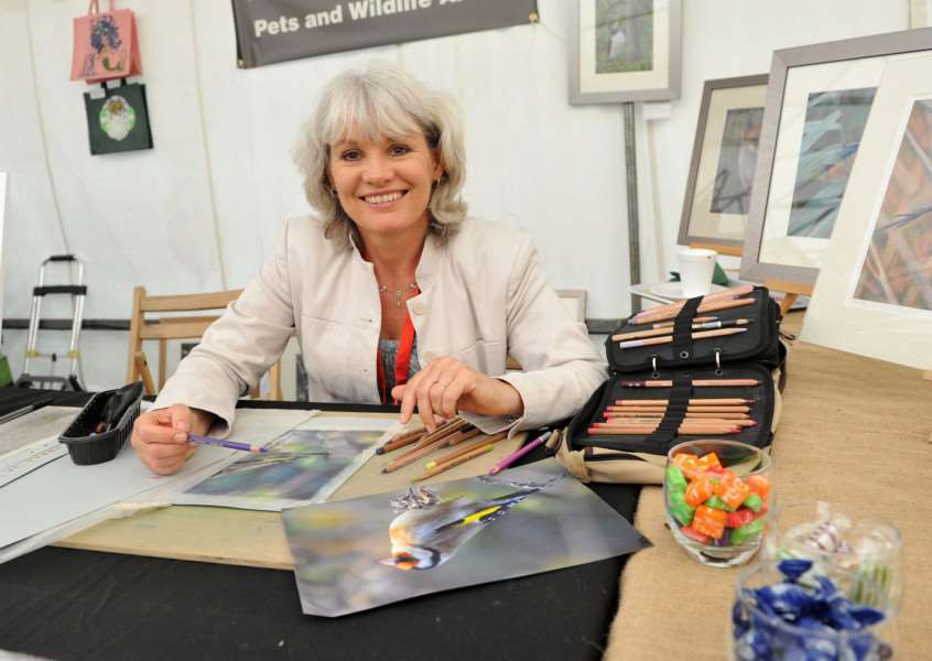 Annette Ashton and her art work at last year's Clare Priory Craft Fair' ANL-151207-201408009
