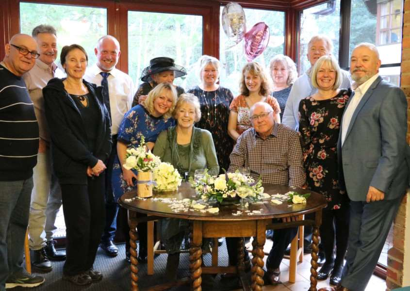 Sue and Mick Randall surrounded by their family and friends after their wedding at St Nicholas Hospice Care ANL-170114-194625001