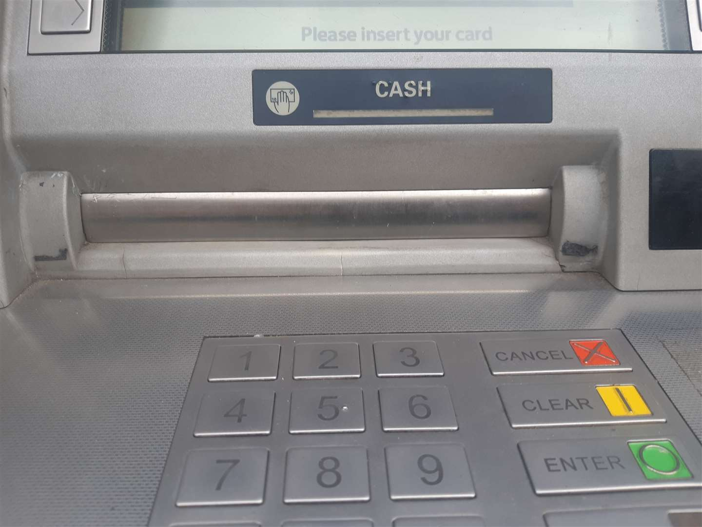 The plastic devices covered the money slot on the cash machine