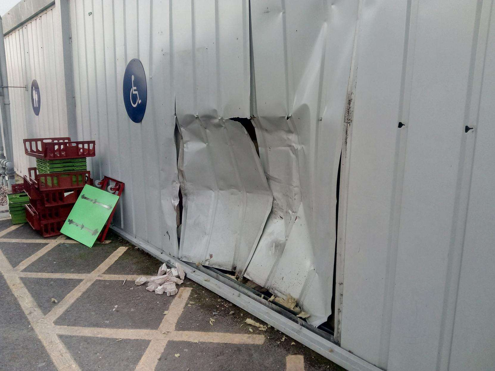 After the attempted thieves couldn't move the cash machine, they used a 4x4 to ram the wall behind it to try dislodge it