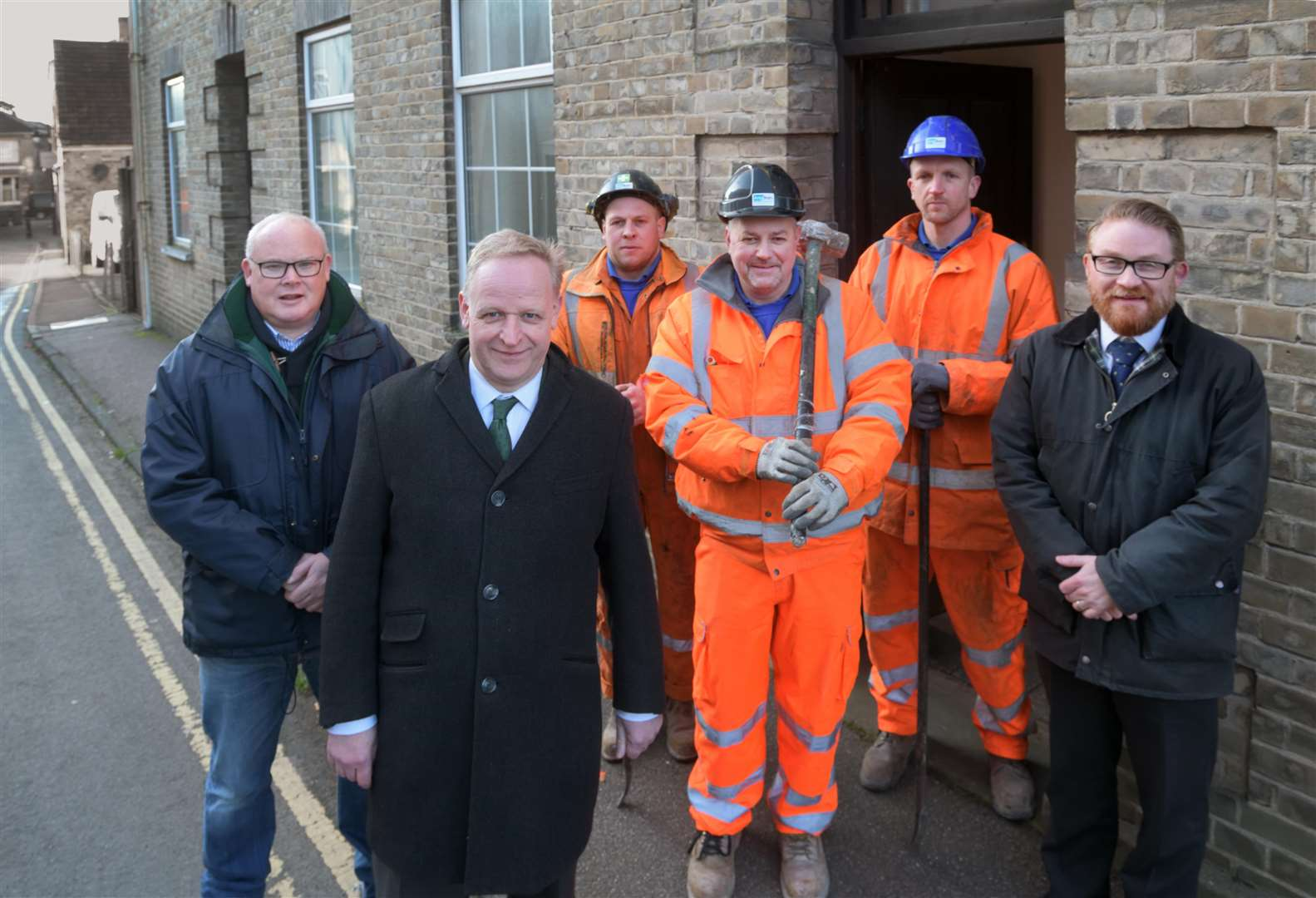 Work begins on the National Centre for Thomas Gainsborough Project in Sudbury, with the demolition of the old Labour Exchange adjacent to Gainsborough's House. Pictured from left to right: Simon Barrett, cabinet member for growth at Babergh District Council; Mark Bills, executive director of Gainsborough's House; John Smith, site supervisor at Anglian Demolition; Darren Harley, foreman at Anglian Demolition; Dean Hart, plant operator at Anglian Demolition; Arthur Charvonia, chief executive of Babergh District Council. Submitted photo. (7153081)
