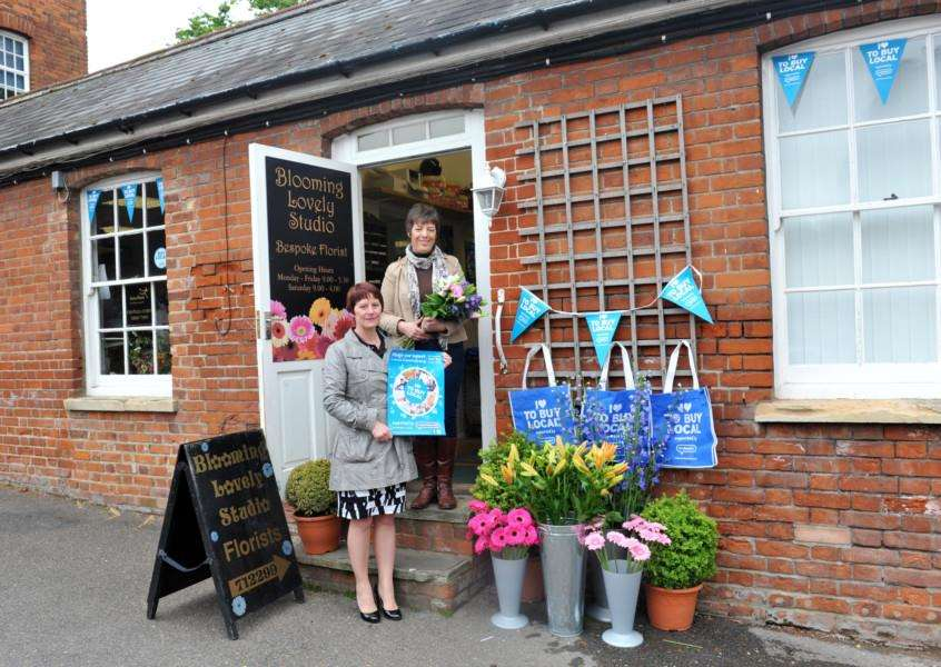 Elaine Carr is promoting the Buy Local campaign with Mandy Stafford outside Blooming Lovely the florist ENGANL00520130522112229