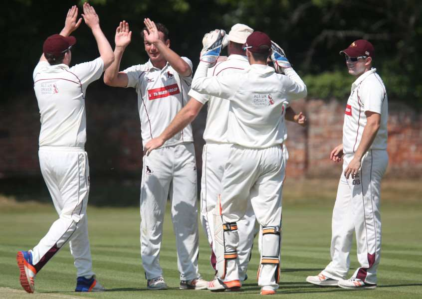 Sudbury's Dustin Melton celebrates taking a Woolpit wicket. Picture: Richard Marsham
