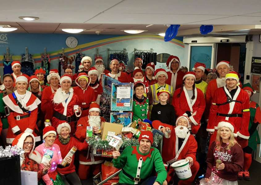 Haverhill Running Club members with some of the donations made in the course of their annual 'Santa Run'