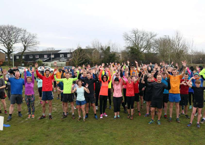 ARMS UP: The parkrun participants show their support ahead of the start of the first ever even in the town