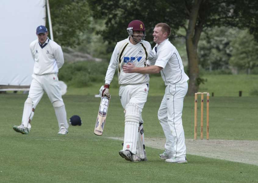 OLD FOES: Former team-mates Ziaf Kulasi (left) and Nathan Twiddy (right) share a joke during Mildenhall's big win.