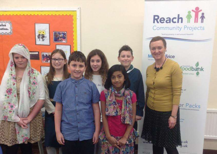 Jo Goodall, from REACH Community Projects, with pupils at St Felix RC Primary School in Haverhill