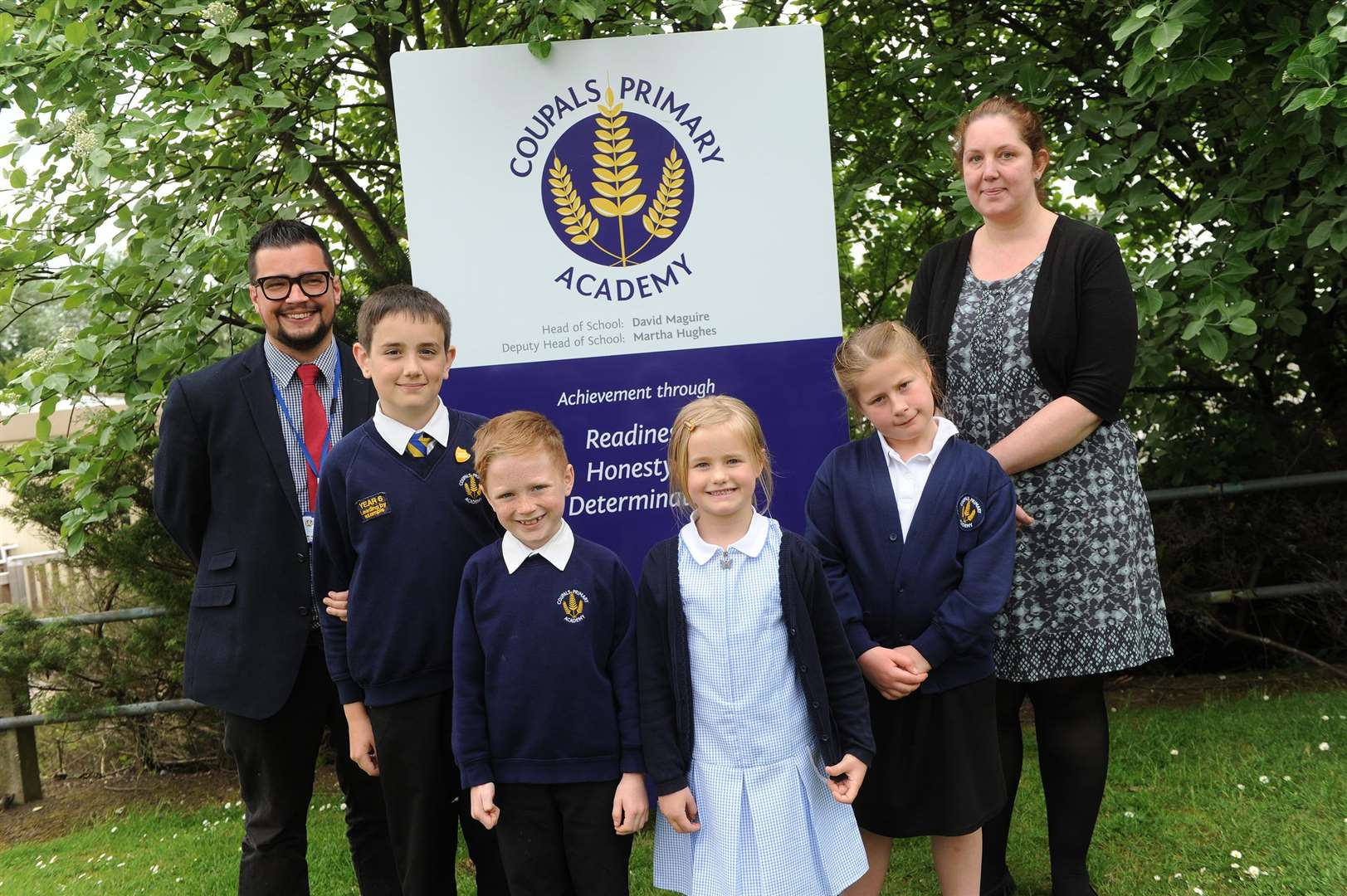 Coupals Primary at Academy at Chalkstone Way will be expanding..Pictured: pupils Sam Fowle, Jack Adams, Tilly Marsh and Jorja Cox along with head Teacher David Maguire and Deputy Head Martha Hughes. (3972515)