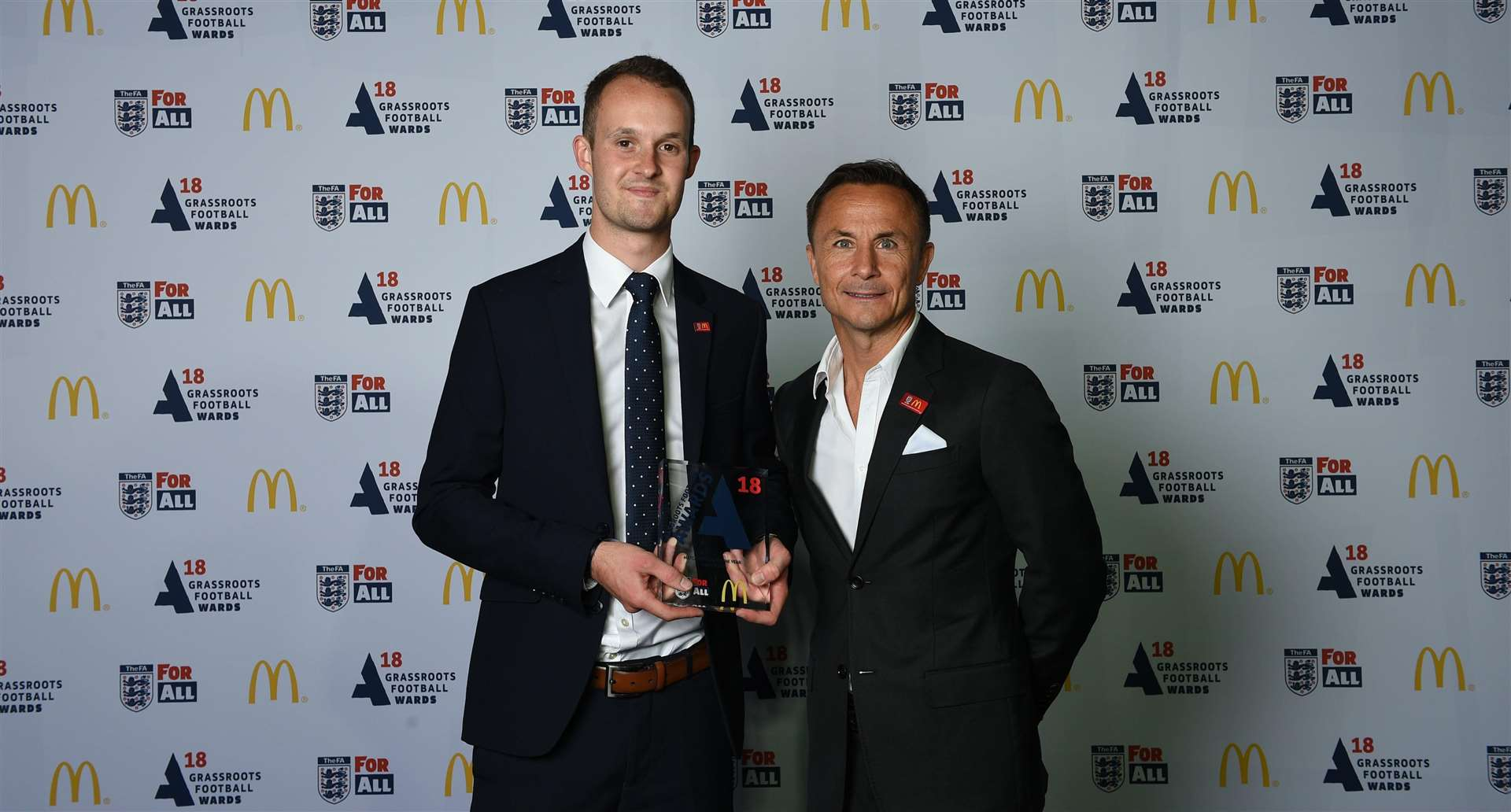 George Byrne (left) receives his Match Official of the Year award from former Chelsea and England midfielder Dennis Wise