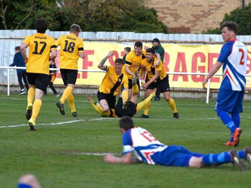 NEARLY THERE: Mildenhall celebrate their late winning goal over FC Clacton. Picture: Mark Westley