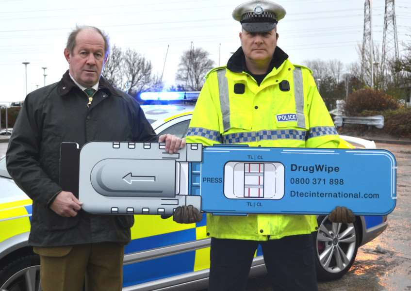 Suffolk PCC Tim Passmore and roads policing officer PC Paul Fletcher with a giant drug wipe replica