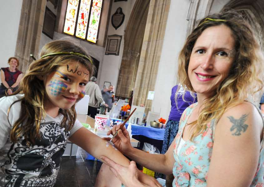 Sudbury hosts its annual Green fair at'St. Peter's Church, Market Hill. FL; Georgina Fairley paints Madison 7 from Sudbury. ANL-150308-203458009