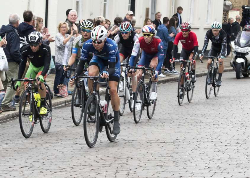 FAST PACE: The riders race through Bury