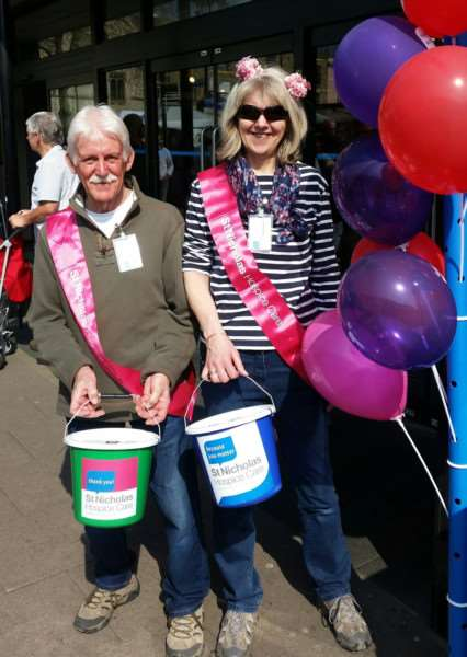 St Nicholas Hospice Care volunteers give up their time to help the charity raise more than �600 with a bucket collection in Bury St Edmunds