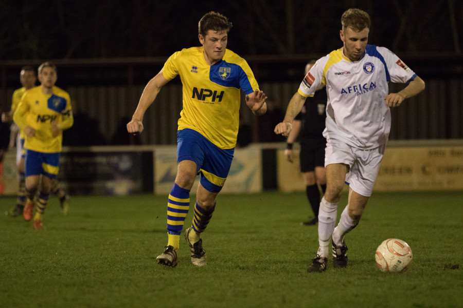 HOT PURSUIT: James Seymour closes down the opposition during Tuesday's 2-0 Suffolk FA Premier Cup defeat