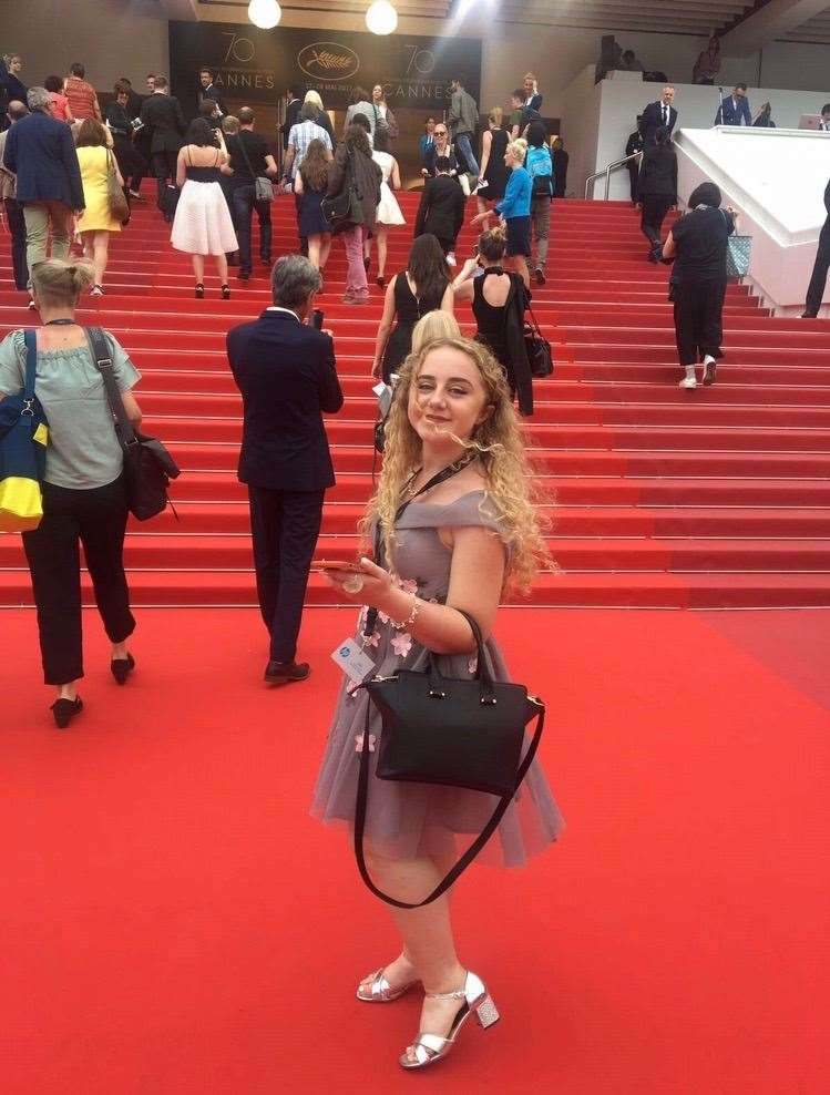 Amelia Thompson on the red carpet at Cannes Film Festival.
