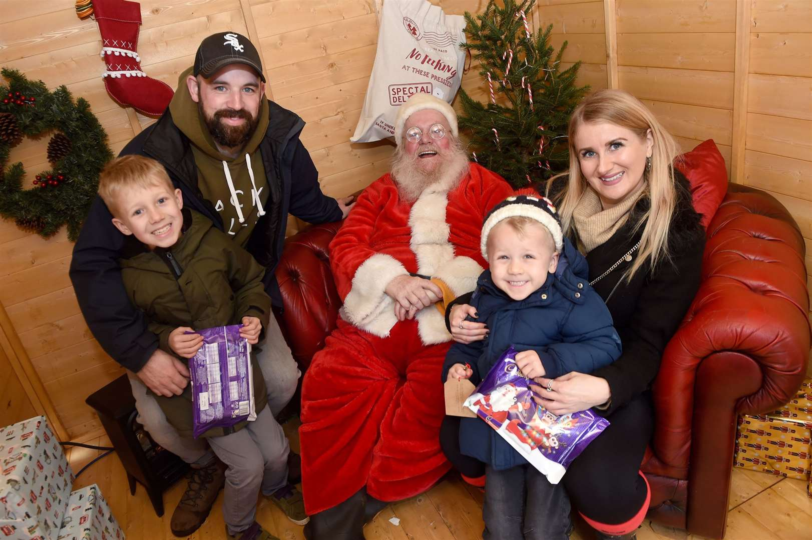 Bury St Edmunds Christmas Fayre 2019...Pictured: visiting Santa - Chris Trenter, Laura Duncan with Isaac (8) and Grayson (4)....PICTURE: Mecha Morton .... (22425932)