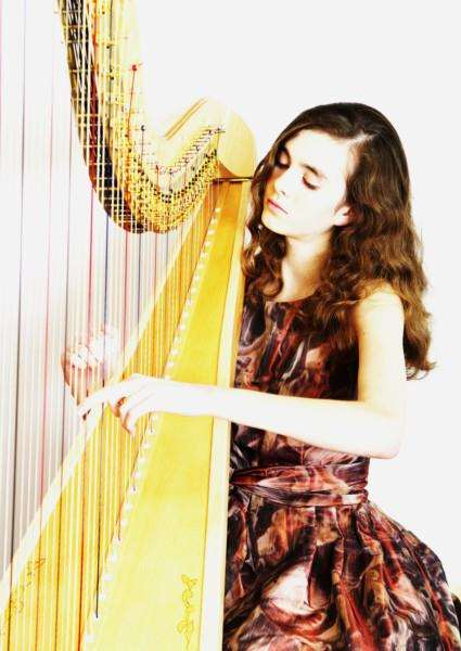 Harpist Imogen Ridge, from Ousden, is performing with Suffolk ladies choir the Aquarius Singers for a concert in Bury St Edmunds. ANL-150610-113336001