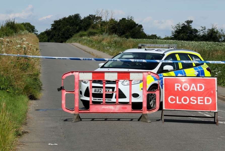 Police close a road close to RAF Marham - Chris Radburn/PA Wire EMN-160721-132058001